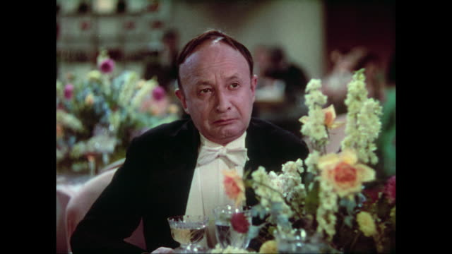 1937 At formal dinner, upset woman (Carole Lombard) points out crying man at other table