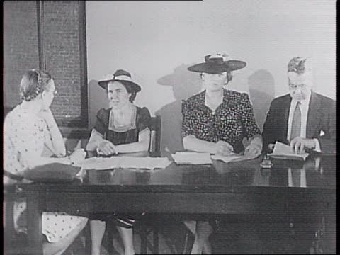 at headquarters of the american committee for the care of european children workers on telephones at table / women lined up at a desk where a workers... - orphan stock videos & royalty-free footage