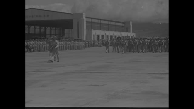 at hickam field, us army general willis hale pins medal on wounded soldier sitting in wheelchair in bathrobe / same soldier posing for photo... - medal stock videos & royalty-free footage