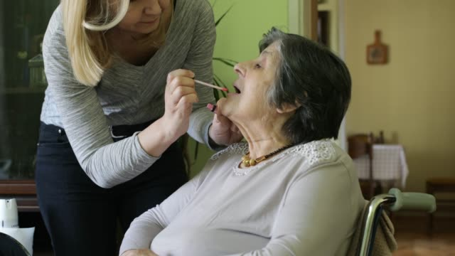 at home caregiver - nursing assistant stock videos and b-roll footage