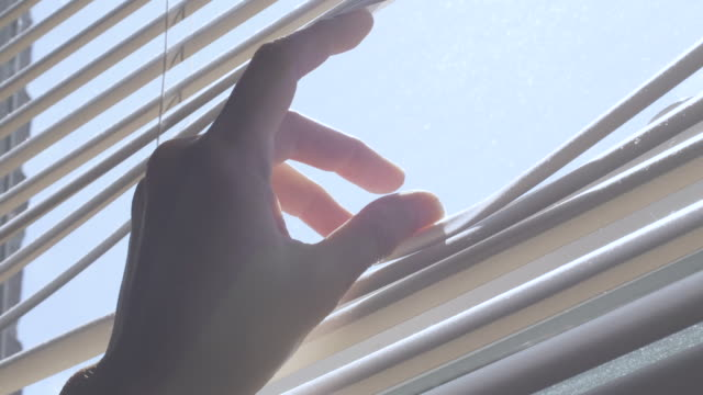 stockvideo's en b-roll-footage met at home looking outside through blinds (lockdown visual) - flexibiliteit