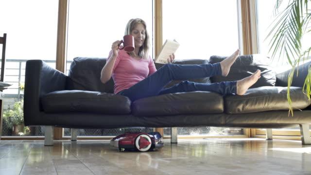 at home with a robot vacuum cleaner - vacuum cleaner stock videos & royalty-free footage