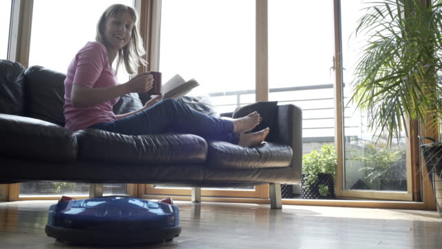 at home with a robot vacuum cleaner - cleaner stock videos & royalty-free footage