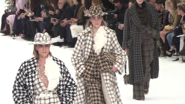 at its paris fall winter 2019/2020 collection show chanel sent models striding through a ski chalet scene after the audience and models observed a... - week video stock e b–roll
