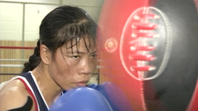 at just 157 centimeters tall and weighing around 50 kilos, mary kom is not exactly intimidating. pune, india. - boxing women's stock videos & royalty-free footage