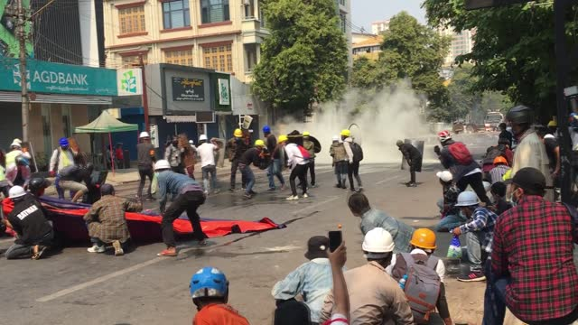 at least 10 people were killed in myanmar on wednesday when the police and security forces used lethal weapons to disperse anti-coup protesters,... - ミャンマー点の映像素材/bロール