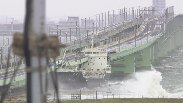 at least 11 people are dead and 680 others injured as the powerful typhoon jebi hit western parts of japan on september 4th jebi is one of the... - ship stock videos & royalty-free footage