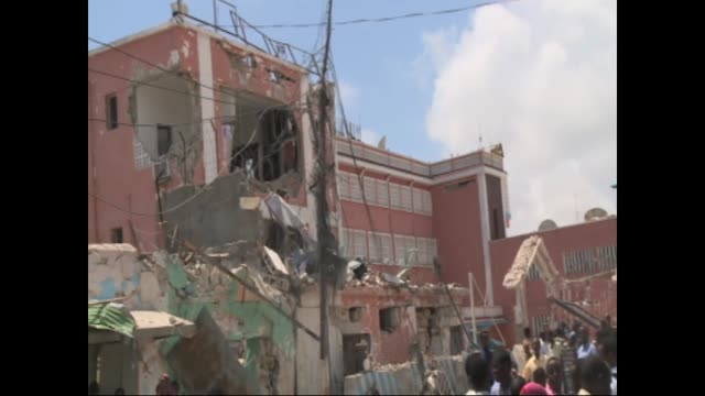 At least 11 people were killed after a car bomb exploded at the main gate of the Sahafi Hotel early on Sunday morning in Mogadishu Somalia