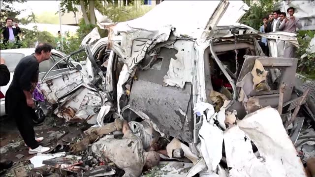 at least 12 people including three nato contractors were killed saturday when a suicide car bomber struck a foreign forces convoy, officials said,... - kabul stock videos & royalty-free footage