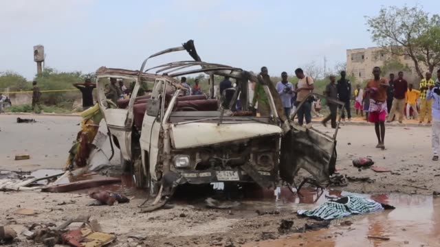 at least 13 people were killed and 10 others wounded in a suicide attack on the country's new armed forces commander in mogadishu somalia on april 09... - good condition stock videos and b-roll footage
