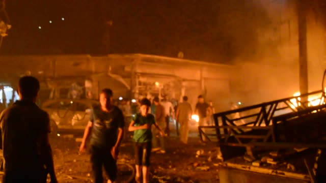 vidéos et rushes de at least 14 people were killed at a car bomb attack in northwestern syria on sunday, according to local sources. the incident took place at a market... - terrorisme