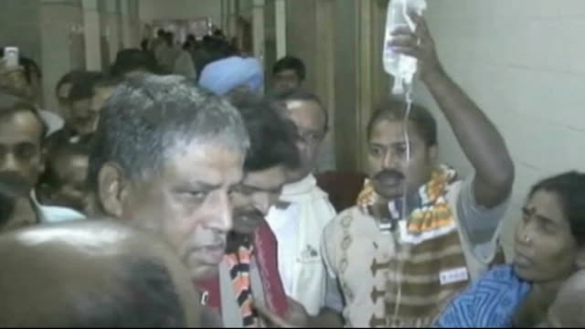at least 143 people die from alcohol poisoning in kolkata int various of group of people including politicians and officials touring hospital ward... - west bengal stock videos and b-roll footage