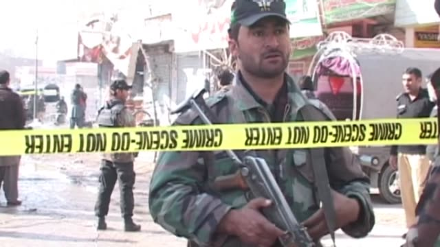 at least 15 dead in southwest pakistan blast a suicide bomber blew himself up outside a polio vaccination centre in the southwestern pakistani city... - polio stock videos and b-roll footage