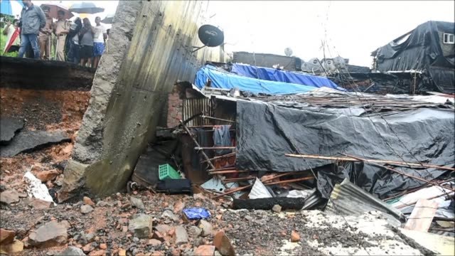 at least 18 people were killed in mumbai when a wall collapsed as the heaviest monsoon rains in a decade brought chaos to india's financial capital... - umgeben stock-videos und b-roll-filmmaterial
