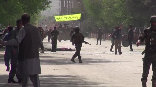 at least 21 people were killed including agence france-presse chief photographer shah marai and three other journalists when two suicide blasts... - kabul video stock e b–roll