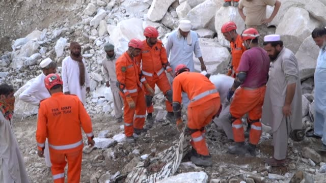 at least 22 miners are killed and more than a dozen are still trapped after a rockslide at a marble mine in northwest pakistan - dozen stock videos & royalty-free footage