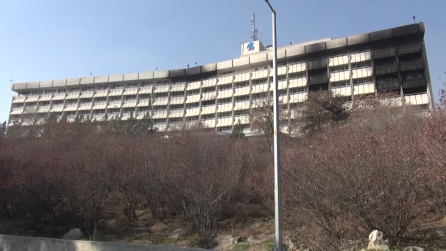 at least 22 people are now known to have died when taliban militants slaughtered guests at a luxury kabul hotel afghan officials say as fears grew... - kabul stock videos & royalty-free footage