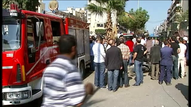 at least 23 people killed in bomb blasts outside iranian embassy in beirut wide shot iranian embassy building with armoured vehicles and soldiers in... - only young men stock videos & royalty-free footage