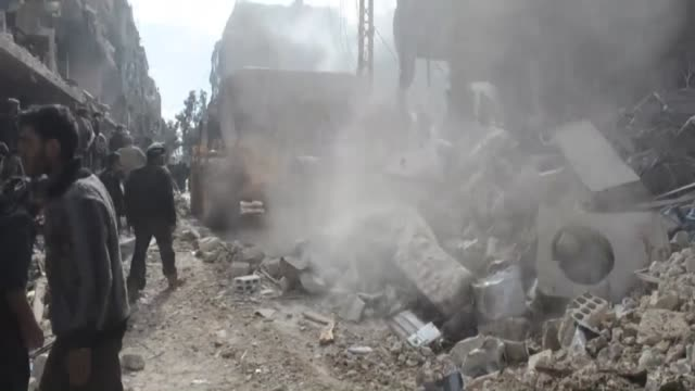 at least 23 people were killed and 50 others were injured in assad regime airstrikes that targeted douma an area 10 km northeast of damascus syria on... - 武力攻撃点の映像素材/bロール