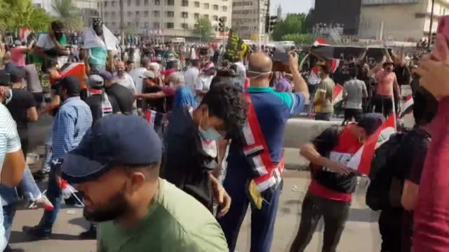 at least 24 people were killed and dozens injured in protests that erupted on friday near baghdad's fortified green zone, according to a medical... - イラク点の映像素材/bロール