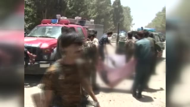 at least 25 people were killed and over 50 others wounded in a suicide car bombing outside a staterun bank in southern afghan province of helmand on... - kabul stock-videos und b-roll-filmmaterial