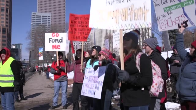 at least 2600 educators across the denver public schools system left their classrooms monday to demand better pay chanting and picketing outside... - streik stock-videos und b-roll-filmmaterial
