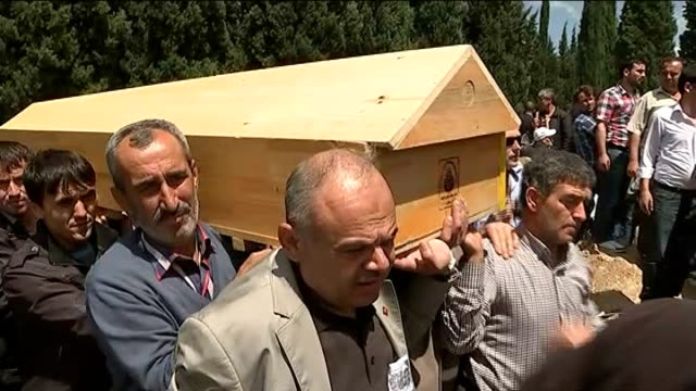 at least 283 dead in soma mining disaster funerals held turkey soma ext row of empty graves dug for victims of soma mining disaster tilt up name of... - carrying stock videos & royalty-free footage