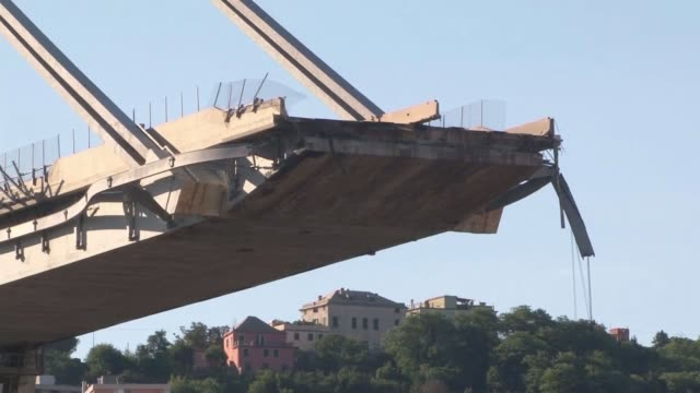stockvideo's en b-roll-footage met at least 39 dead in genoa bridge collapse italy liguria genoa collapsed morandi bridge liguria genoa ext bridge with end of section that collapsed... - human interest