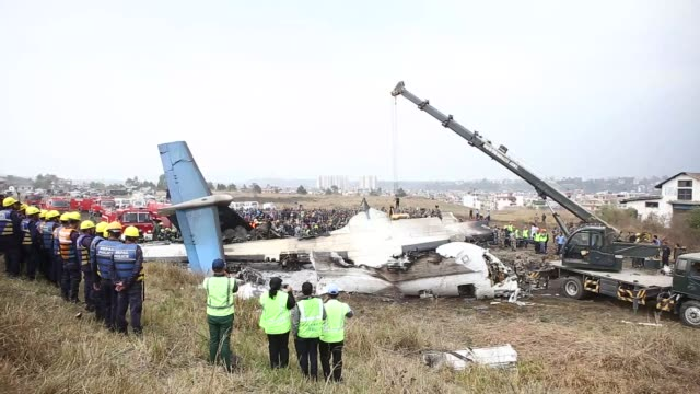 at least 39 passengers were killed after a passenger aircraft of a private bangladeshi airline skidded off the runway and caught fire in capital... - 航空事故点の映像素材/bロール