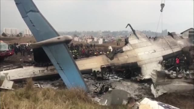 vídeos de stock e filmes b-roll de at least 40 people are killed and 23 injured when a bangladeshi plane crashed and burst into flames near kathmandu airport in the worst aviation... - acidente de avião