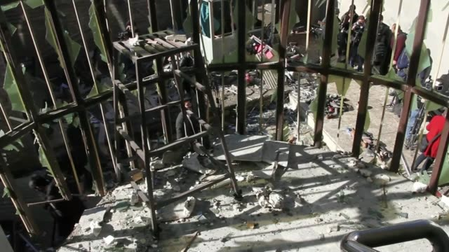 at least 41 people dead in kabul suicide attack kabul gvs bombdamaged tabayan cultural centre in aftermath of suicide bomb attack soldier stand guard... - kabul stock-videos und b-roll-filmmaterial