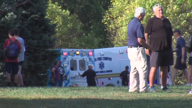 at least 5 confirmed runners were rushed to the hospital due to heat exhaustion at delco champs cross country race. - ヒート点の映像素材/bロール