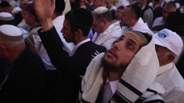 at least 50000 jewish worshippers attended a prayer ceremony at jerusalems western wall on monday as israel marked the week long passover festival - attending stock videos & royalty-free footage