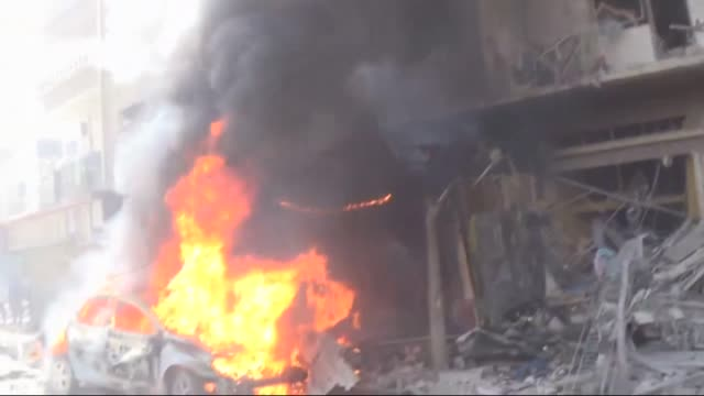 at least 6 people killed after assad forces attack to douma district of east ghouta on 27 july, 2015. syrian firefighters extinguish the fire that... - 2015 stock-videos und b-roll-filmmaterial