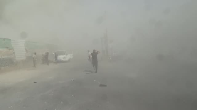vídeos de stock, filmes e b-roll de at least 6 syrians are killed and many others wounded in vacuum bomb attack staged by syrian regime forces in hish town of idlib city of syria on... - bombardeamento