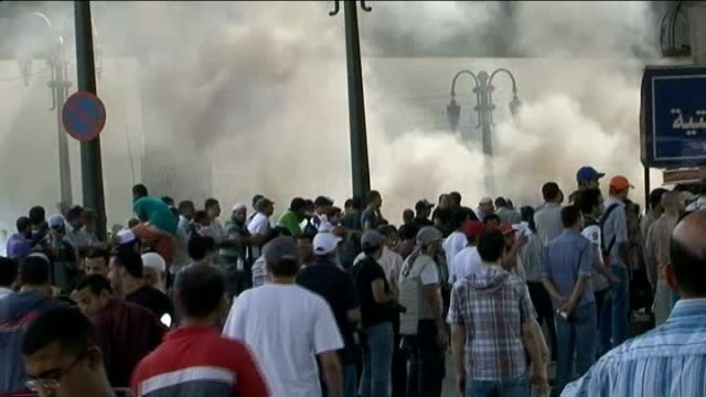 At least 60 die in clashes between Muslim Brotherhood and security forces / diplomacy EGYPT Cairo EXT Men in Ramses Square chanting with megaphone...