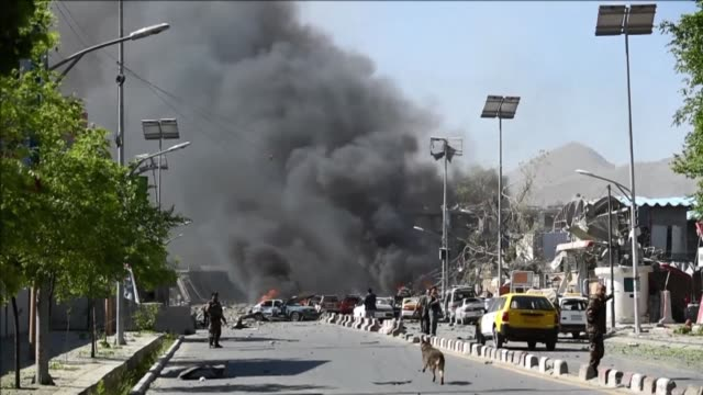 at least 64 people are killed and hundreds wounded when a massive truck bomb ripped through kabul's diplomatic quarter shattering the morning rush... - kabul stock videos & royalty-free footage