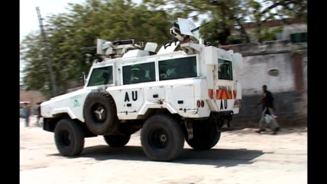 at least 74 people killed in suicide bomb attacks during world cup final t10100702 african union patrol vehicle along in mogadishu clouds of smoke in... - awning stock videos & royalty-free footage