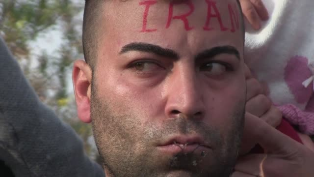 stockvideo's en b-roll-footage met at least five migrants stuck on the greek macedonian border have sewn their lips in protest at not being allowed to continue their journey to europe - menselijke mond
