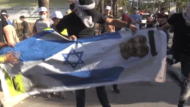 at least five palestinians were wounded on wednesday, aug. 19, by israeli forces as they staged a protest against the israeli-uae deal, as well as... - palestinian stock videos & royalty-free footage
