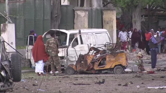 At least five people are killed after a minibus laden with explosives blows up in Mogadishu just as the troubled country's new prime minister unveils...