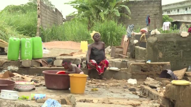at least five people have been killed in an abidjan neighbourhood and residents left destitute after heavy rains cause flooding in the ivorian capital - côte d'ivoire stock videos & royalty-free footage