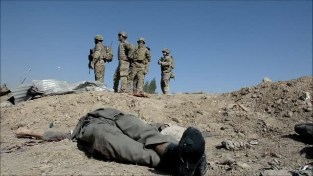 At least four Afghan intelligence agents are killed and dozens of civilians are wounded when a group of Taliban militants attacks an intelligence...