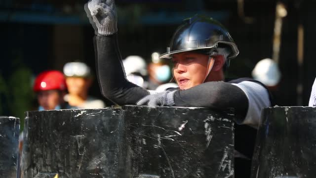 at least four people have been killed and several others injured on monday, march 8, after security forces fired live bullets at protesters in two... - ミャンマー点の映像素材/bロール