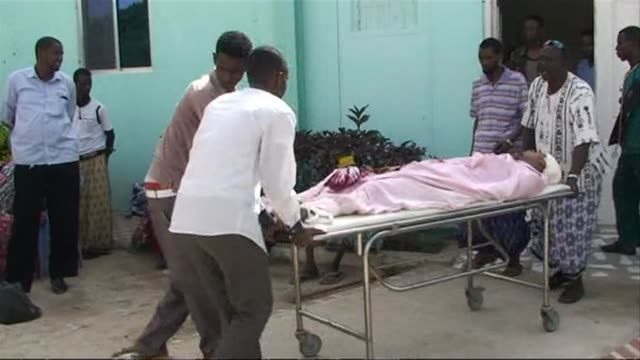 At least four people including a government official were killed Friday in an Islamist militant car bomb attack outside a top hotel in Somalias...