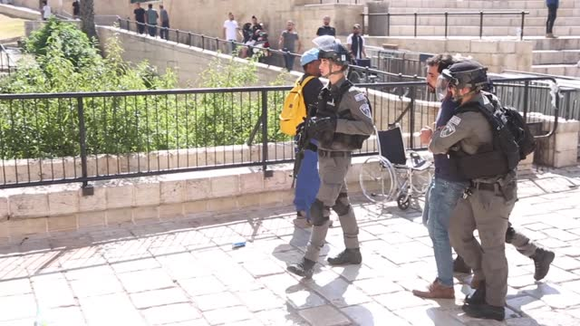 at least one palestinian was injured and three people were detained by israeli police as they intervened in groups who gathered at the damascus gate... - gaza strip stock videos & royalty-free footage