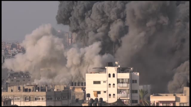 vídeos de stock e filmes b-roll de at least seven palestinians were injured thursday by an israeli airstrike that targeted a cultural center west of gaza city according to gaza's... - ataque aéreo