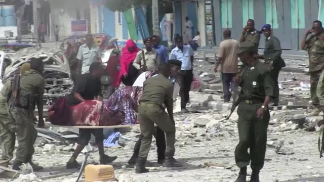 At least seven people are killed after two car bombs explode outside a popular Mogadishu hotel and gunmen force their way inside the building and...