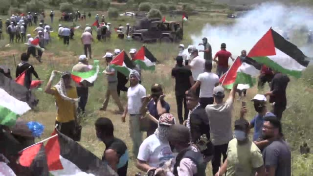 at least six palestinians on friday were affected by tear gas bombs fired by israeli security forces in nablus city of west bank during a protest... - historical palestine stock videos & royalty-free footage