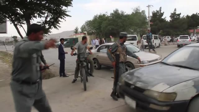 at least six people were killed and 87 others wounded when multiple blasts ripped through a funeral ceremony at a cemetery in the capital kabul on... - kabul stock-videos und b-roll-filmmaterial